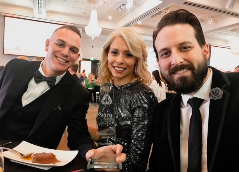 Eric, Monica, and Ryan accepting the 2019 Business Excellence Award